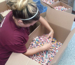 Alyssa getting TONS of candy ready to toss out  in local parades in the summer.